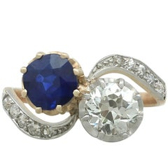 1910s French 1.55 Ct Sapphire and 1.34 Ct Diamond Yellow Gold Twist Ring