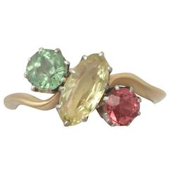 1910s Sapphire, Garnet and Tourmaline and 18k Yellow Gold Trilogy Ring