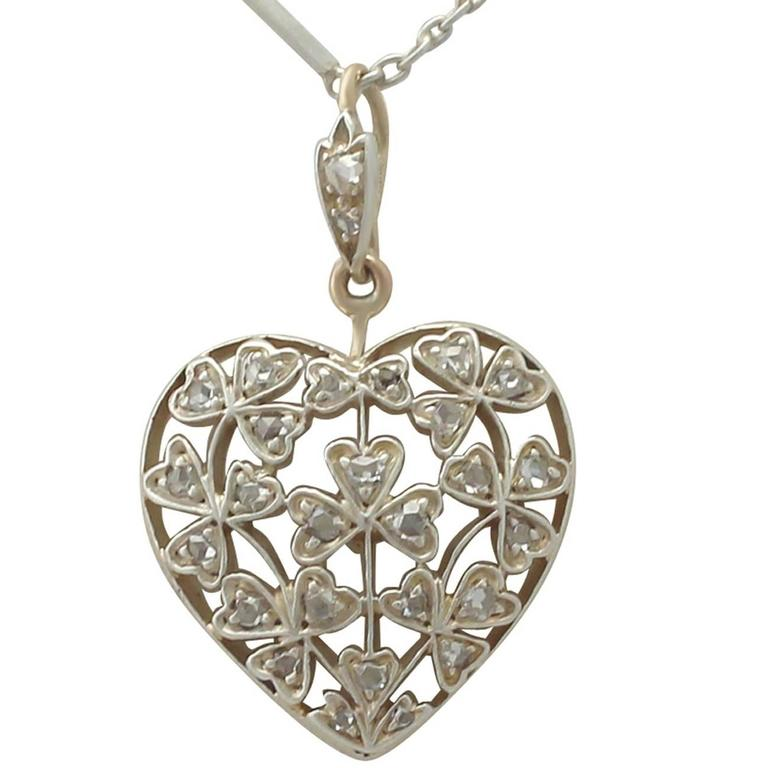 Antique Victorian 0.70 Carat Diamond and 12k Yellow Gold Pendant For Sale