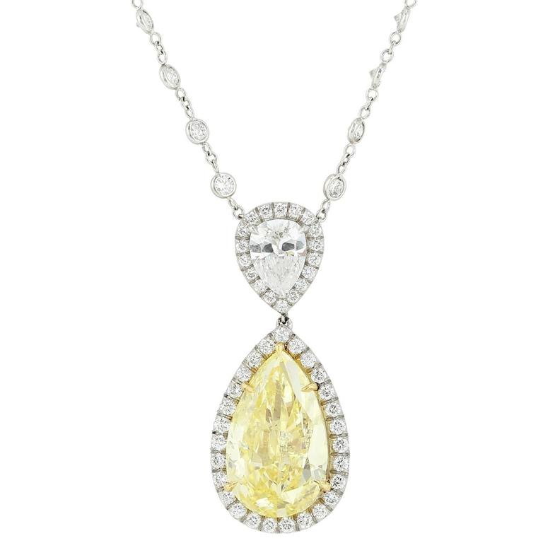 GIA Certified Fancy Intense Yellow Pear Shape Diamond 5.03 cts Pendant.