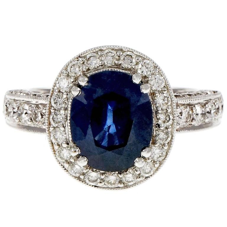 Oval 3.48 Carat Royal Blue Sapphire Diamond Gold Halo Engagement Ring