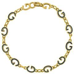 GUCCI Vintage Enameled 'G' Link Gold Bracelet