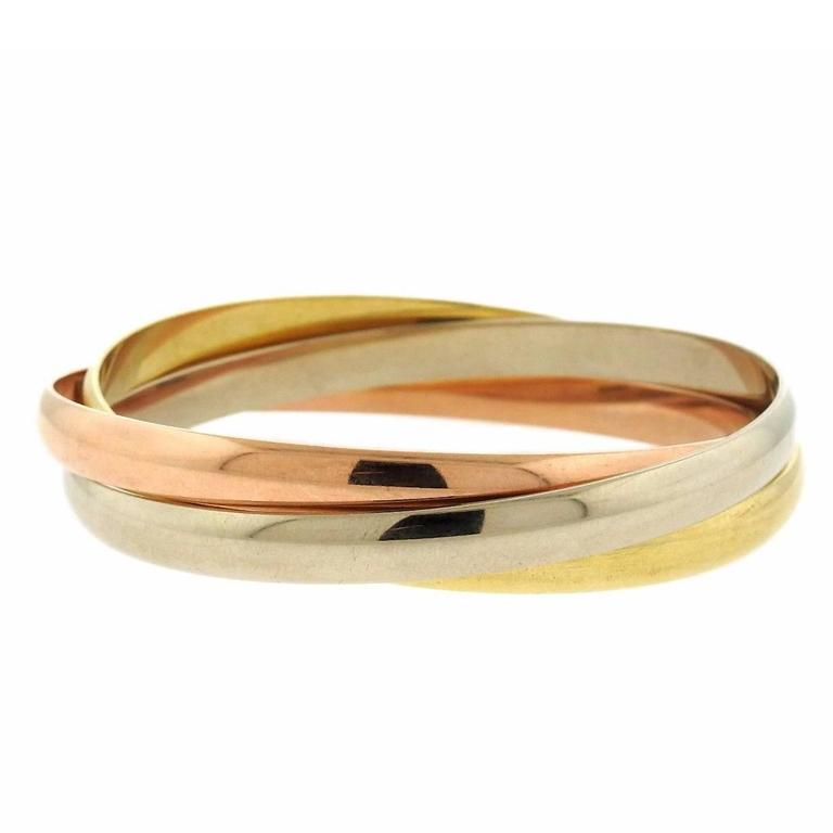 95b92fd8bfcef Cartier Trinity Tri Color Gold Rolling Bangle Bracelet