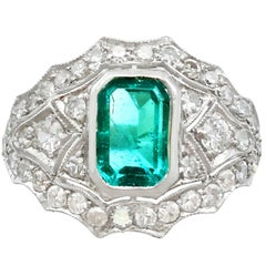 1950s 1.49 Carat Emerald and 1.15 Carat Diamond Platinum Cocktail Ring