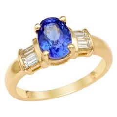 Oval Tanzanite Baguette Diamond and Gold Ring