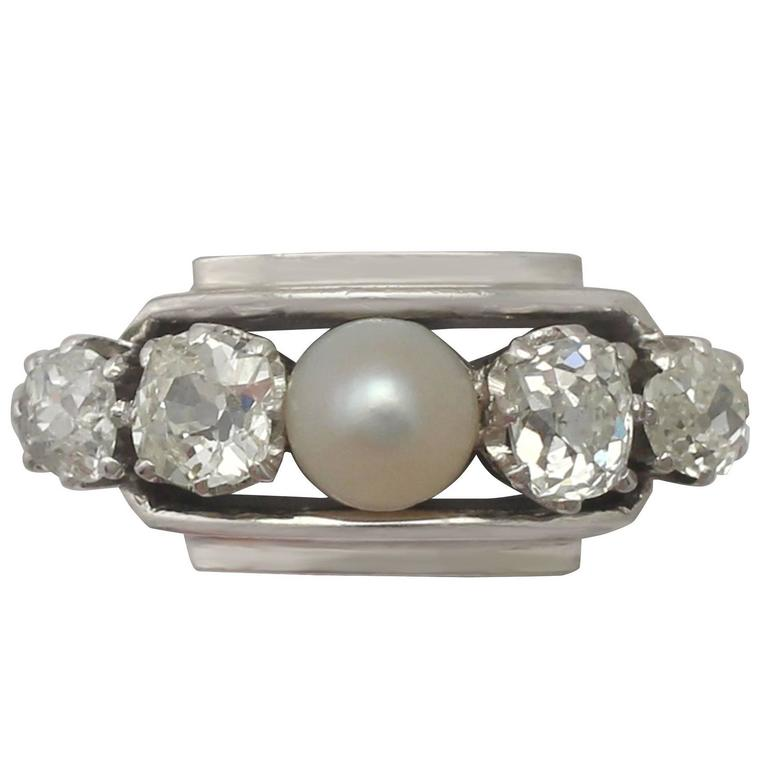 1940s Antique Pearl and 1.02 Carat Diamond Platinum Cocktail Ring