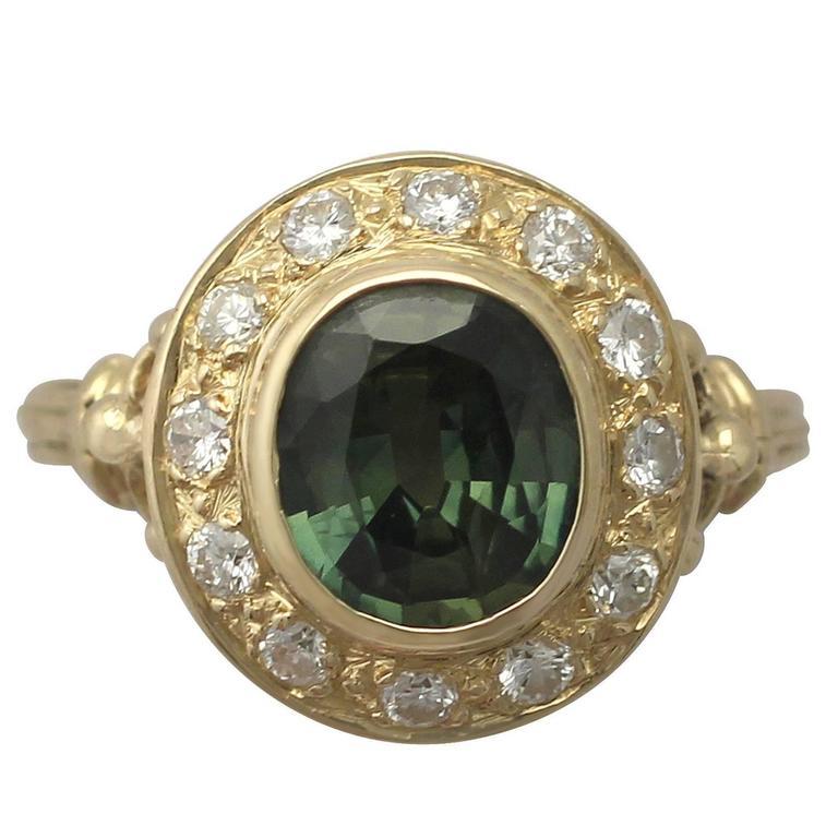 1970s 1.45 Carat Peridot and Diamond Yellow Gold Cocktail Ring