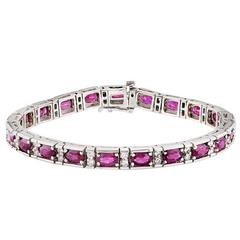 Oval Ruby and Diamond Patterned White Gold Bracelet