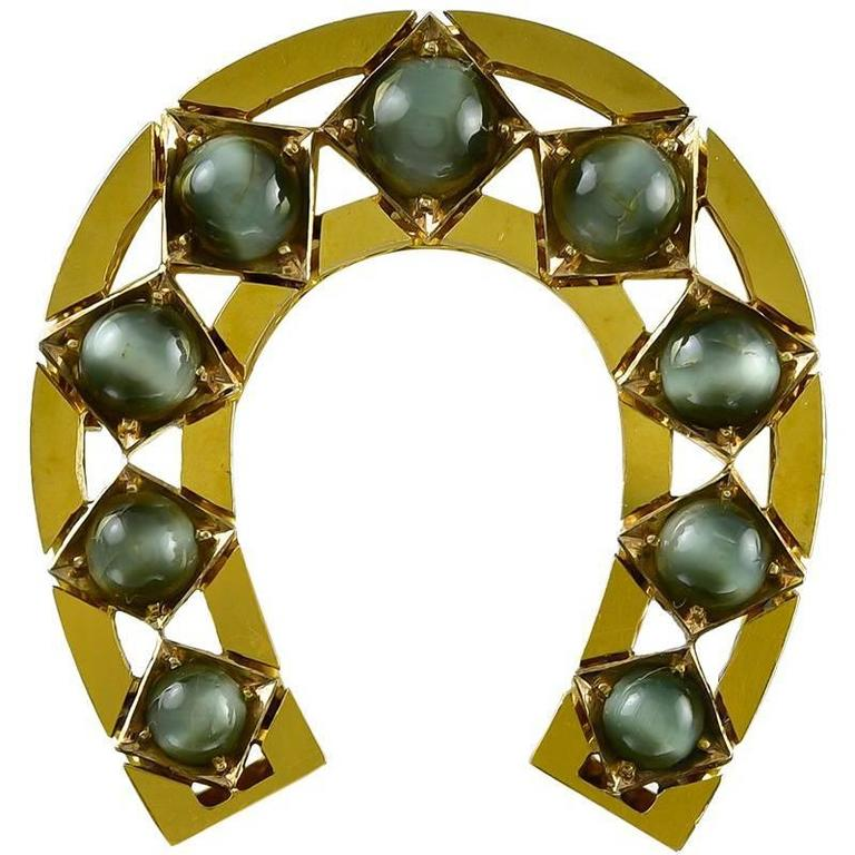 Victorian Chrysoberyl Gold Cat's Eye Horseshoe Brooch For Sale