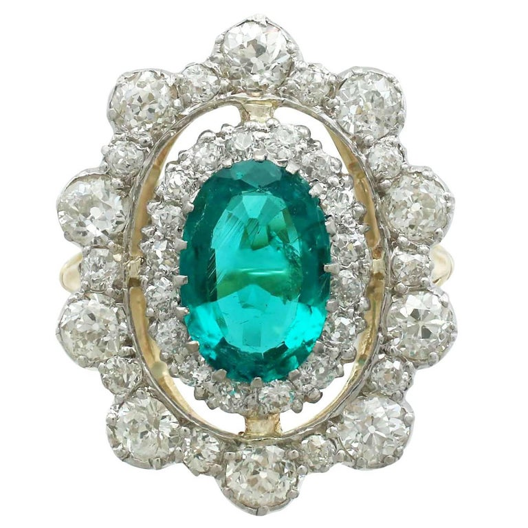 1930s 3.12 Carat Emerald and 3.15 Carat Diamond Yellow Gold Cocktail Ring For Sale