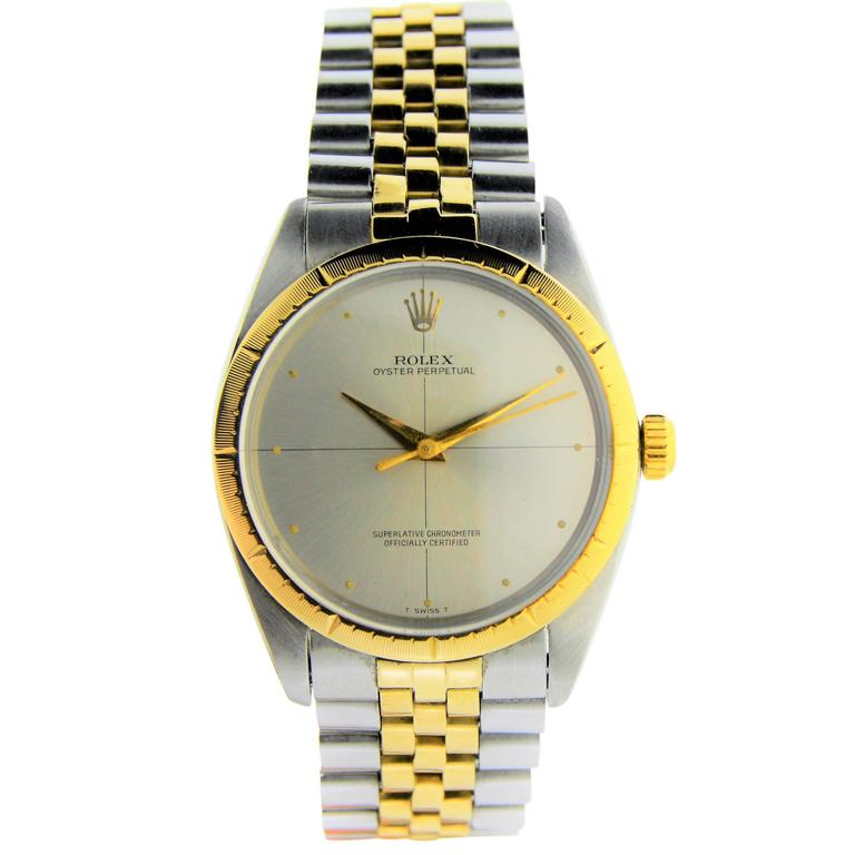 FACTORY / HOUSE: Rolex Watch Company STYLE / REFERENCE: Zephyr / 1008 METAL / MATERIAL: 2 Tone Stainless Steel and 14Kt. Yellow Gold Fluted Bezel DIMENSIONS:  41.5mm  X  34mm CIRCA: 1964 MOVEMENT / CALIBER: 26 Jewels / Oyster Perpetual  DIAL /