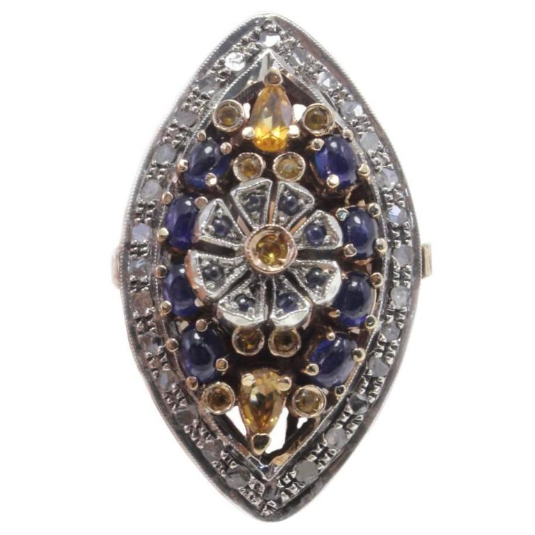 Diamonds Sapphire Gold and Silver Ring