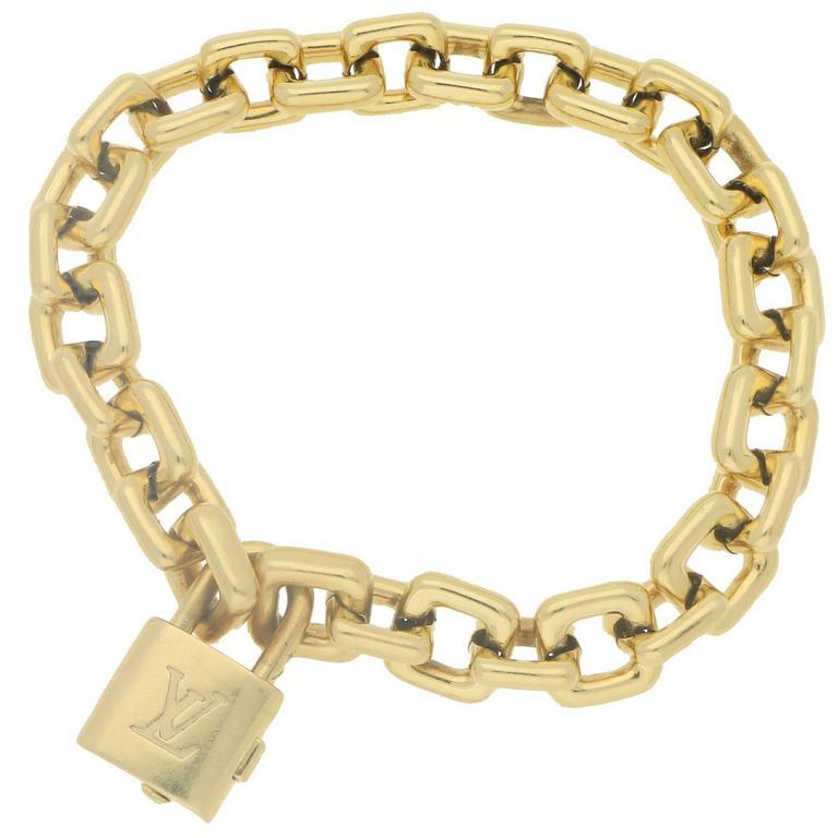 aac2d1031a10 Vintage 18 Karat Gold Louis Vuitton Padlock Bracelet at 1stdibs