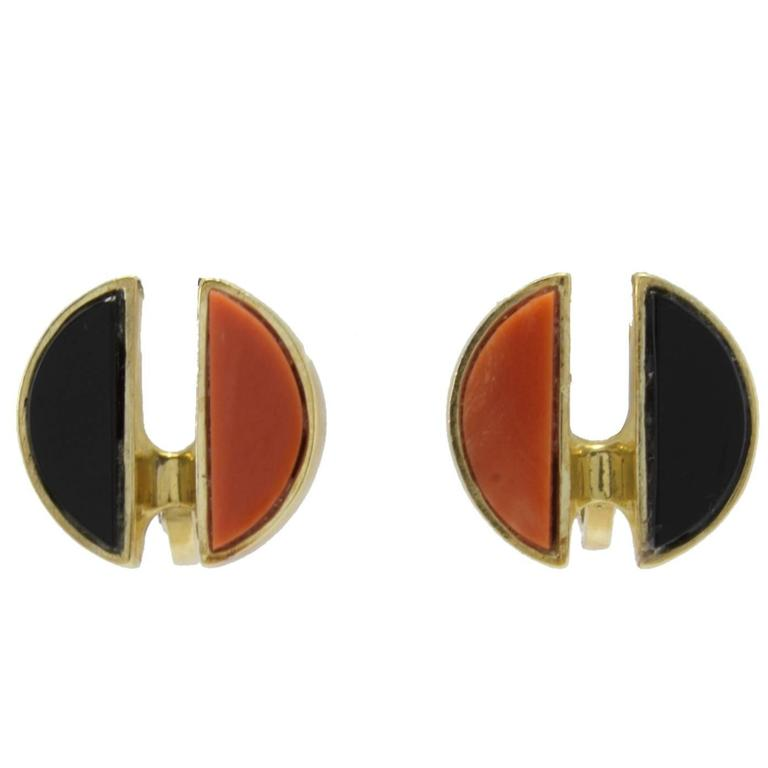Clip-on earrings in 18k yellow gold mounted with coral and onyx. Coral 1.60 gr Onyx 1.40 gr Tot.Weight 12.90 gr R.F ucea  We hereby inform our customers that in the case of return they will not charge any cost about customs taxes and duties; the
