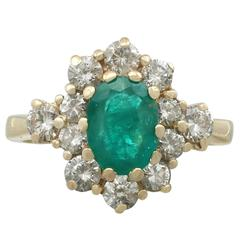 1970s 1.30 Carat Emerald and Diamond Yellow Gold Ring
