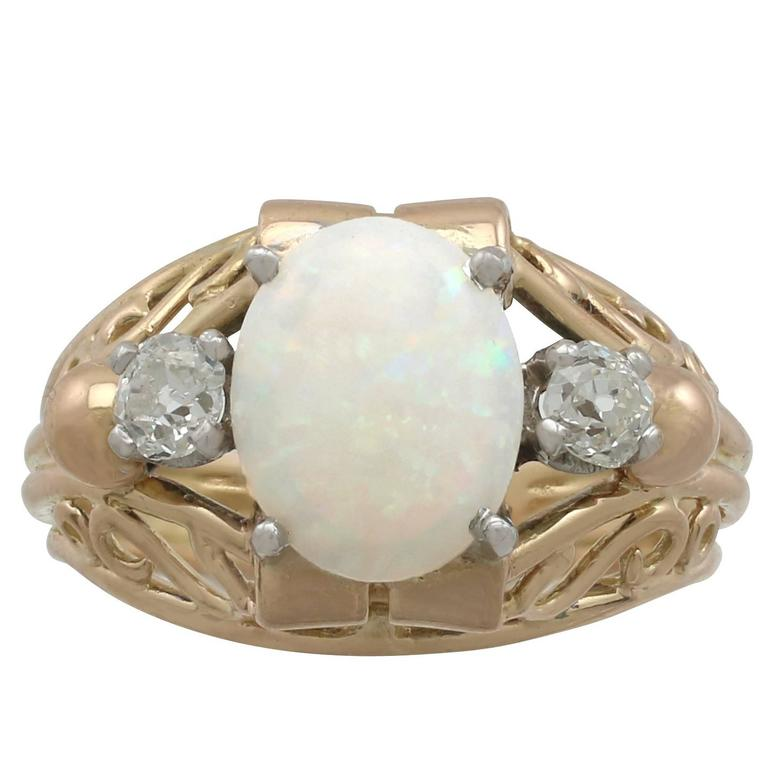 1930s French 1.82 Carat Opal and Diamond Yellow Gold Ring For Sale