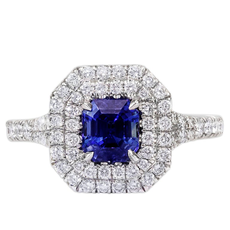 1.18 Carat Blue Sapphire and Diamond Halo Ring For Sale