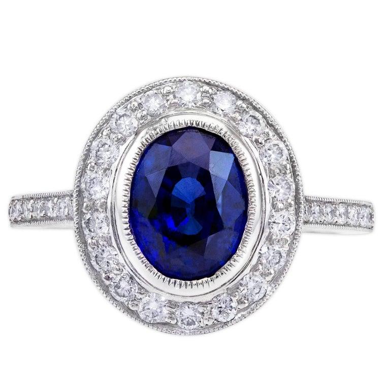 3.60 Carat Blue Sapphire Diamond Halo Ring For Sale