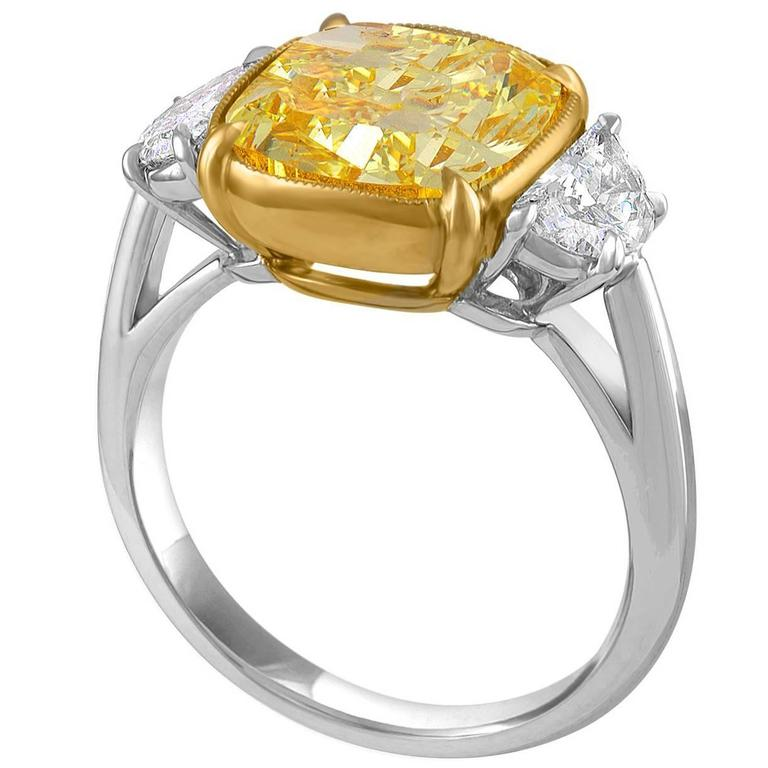 5.04 Carat Cushion Cut GIA Fancy Intense Yellow Diamond Gold Platinum Ring  For Sale