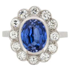 French 3.00 Carat Sapphire and 1.20 Carats Diamonds Halo Ring circa 1940s