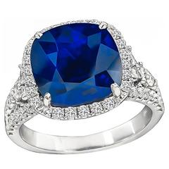 Enticing 6.85 Carat Sapphire Diamond Halo Ring