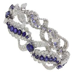 c 17,95 Sapphire and ct 9,85 Diamond Gold Clamper Bracelet