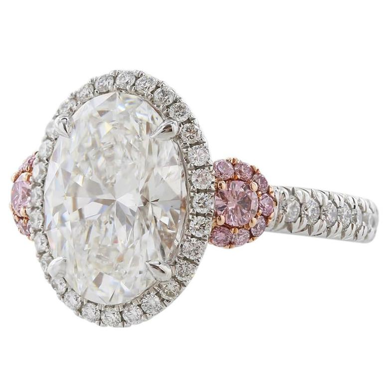 GIA Certified 3.01 Carat Oval Diamond Fancy Pink Diamond Platinum Ring 1