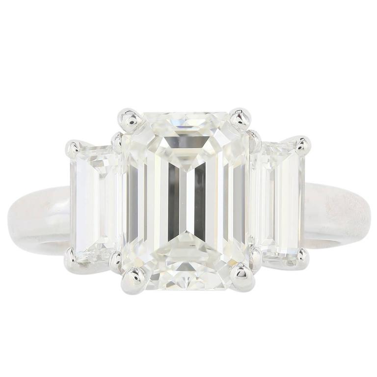 GIA Certified 3.01 Carat Emerald Cut Three Stone Diamond Engagement Ring For Sale
