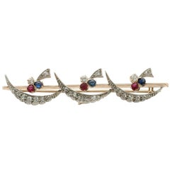 1880s Diamond Ruby and Sapphire Yellow Gold Bar Brooch