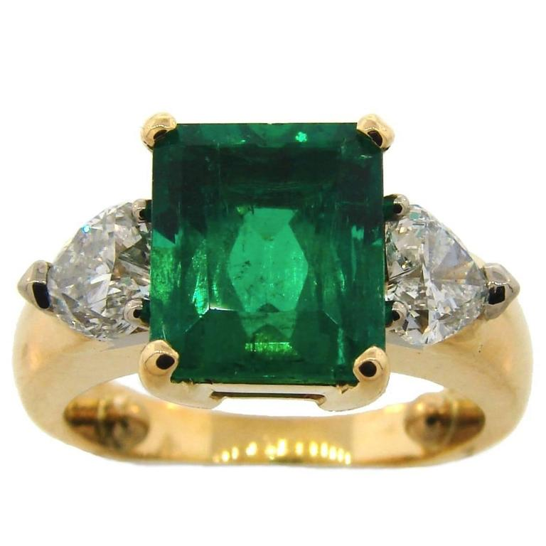 3.71 Carat Colombian Emerald GIA Diamond Yellow Gold Three-Stone Ring
