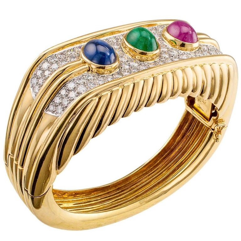 1980s Diamond Emerald Ruby Sapphire Gold Bangle Bracelet For Sale