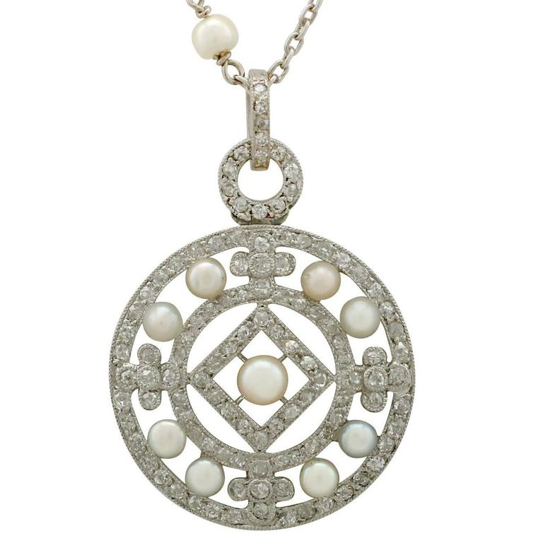 1920s Seed Pearl and 1.11 Carat Diamond, Platinum Pendant For Sale