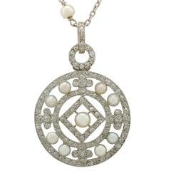 1920s Seed Pearl and 1.11 Carat Diamond, Platinum Pendant
