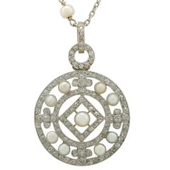 1920s Seed Pearl and 1.11 Carat Diamond, Platinum Pendant