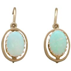 1930s 0.50 Carat Opal and 14 Carat Yellow Gold Drop Earrings