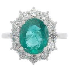 18 Carat White Gold 2.68 Carat Emerald and 1.29 Carat Diamond Cluster Ring