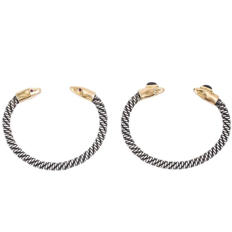 Pair of Gold and Sterling Serpent Bangles