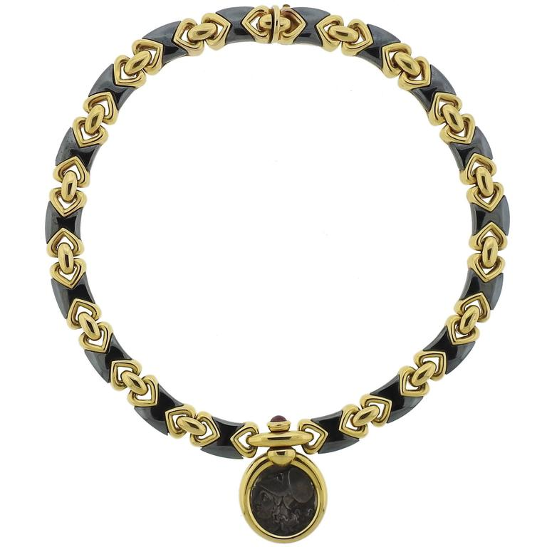 Bulgari Hematite Ancient Coin Ruby Gold Pendant Necklace For Sale