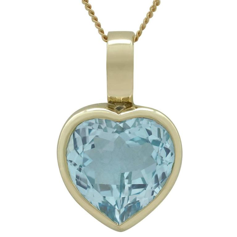 1990s 13.50 Carat Topaz and Yellow Gold Heart Pendant