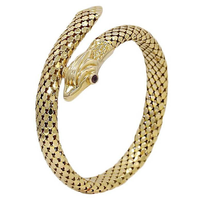Yellow Gold Serpent Coil Bracelet with Ruby Eyes For Sale
