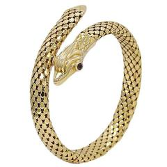 Yellow Gold Serpent Coil Bracelet with Ruby Eyes