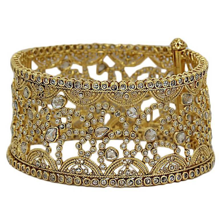 Yellow Gold Hinged Bangle Bracelet with 16.25 Carats of Uncut Diamonds