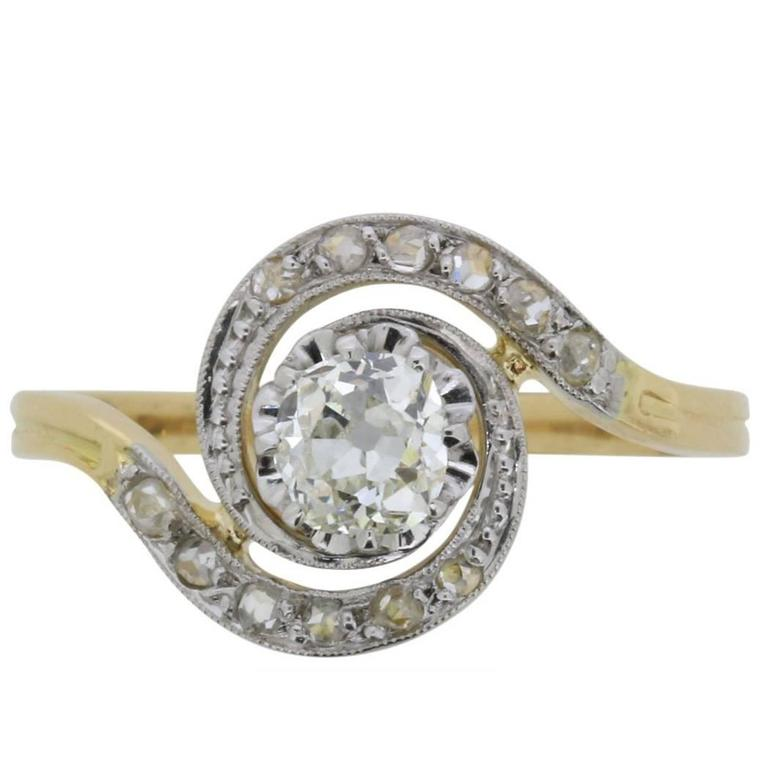 Edwardian Diamond Solitaire Twist Ring with Set Shoulders, circa 1910s