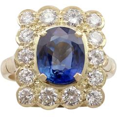 1990s 3.36 Carat Sapphire and 2.50 Carat Diamond Yellow Gold Ring