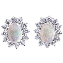 0.88 Carat Opal Diamond Gold Oval Halo Stud Earrings