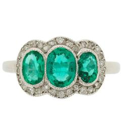 Vintage Triple Halo Emerald and Diamond Ring, circa 1950s