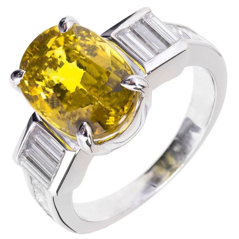GIA 6.08 Carat Natural Oval Yellow Sapphire Diamond Platinum Engagement Ring