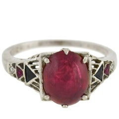 Art Deco GIA Certified 3.50 Carat Natural Ruby Cabochon, Onyx, and Diamond Ring