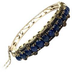Cabochon Sapphire Gold Bangle Bracelet