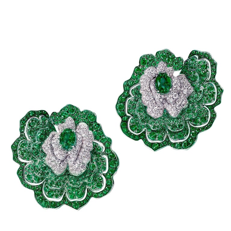Earrings crafted in 18K White Gold, White Diamonds and Emeralds For Sale